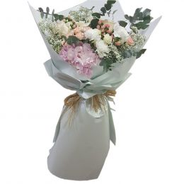 Hand Bouquet With Mixed Rose Flowers In White Paper